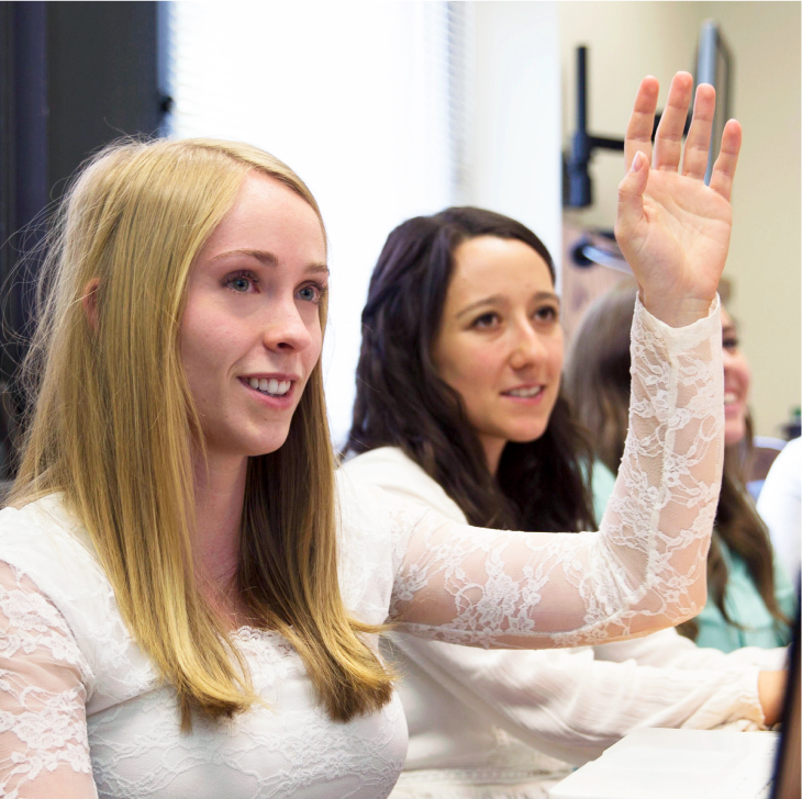 Girl raising hand to ask a question