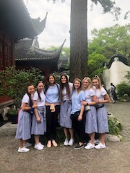 Liz Darger and the BYU Cougarettes sightseeing at the Cheghuan Temple in Shanghai as part of the China Spectacular Tour. May 2019. Names (left to right): McKinley Hawkes, Jamie Bacon, Liz Darger, Annika Peterson, Sarah Barrus, Caroline Tarbet, and Cassidy Riggs