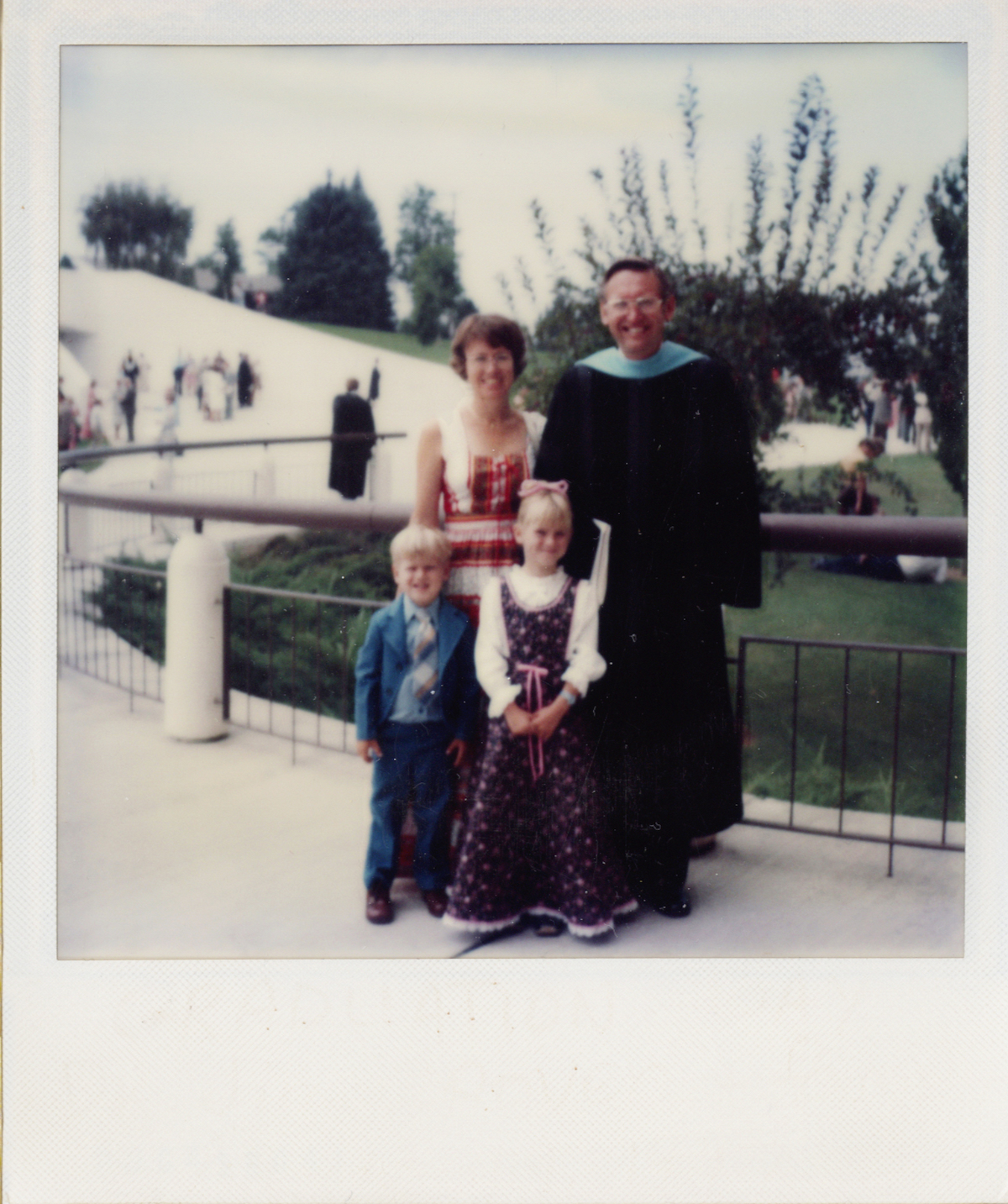 Man with family at graduate on BYU campus.