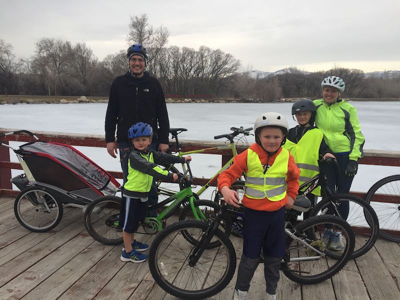 Family posing for a bike ride in the winter.