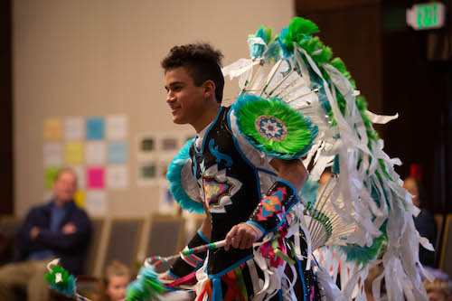 "Shylo Allison (Dine'), a Fancy Feather Dancer at the ""Building Cultural Bridges through the Arts,"" a breakout session taught by Brenda Beyal, Rachel Marie Kimball, and Mike Larsen."
