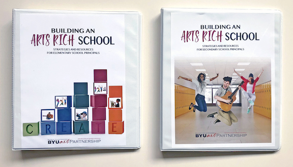 The two binders that the principals received