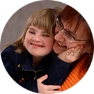 A disabled child and her teaching assistant