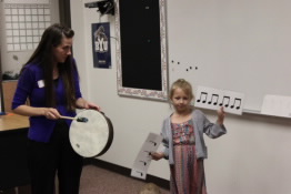 Playing a drum with kids